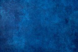 Worn out cobalt blue grunge background or texture