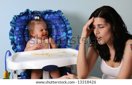 Worn-out mother with crying baby