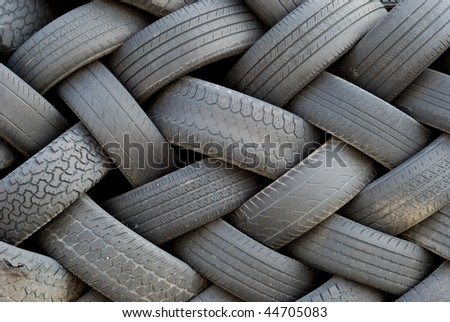 Worn out old tires, stacked artfully