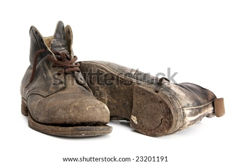 Worn-out old work boots, isolated on white.