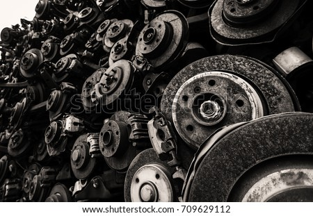 Worn out used rusty brake discs display in monochromatic #709629112