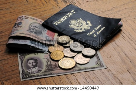 Worn Passport and Cash