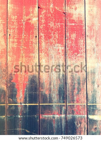 Worn side of red barn