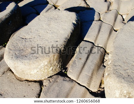 Worn stepping stones in ancient Pompeii with chariot wheel grooves etched in the stone #1260656068