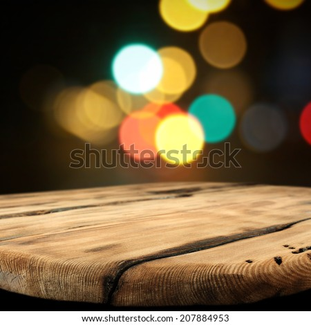 worn table and night space