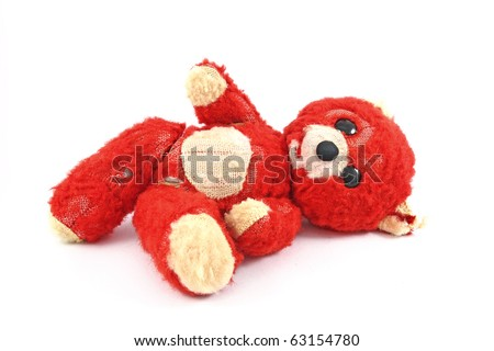 Worn teddy bear on white background