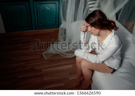 worried and thoughtful woman in bed #1366626590