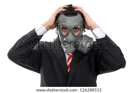 Stock Photo Worried business man with gas mask, close up