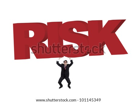 Worried businessman carrying a huge and heavy sign of risk. Shot in studio isolated on white