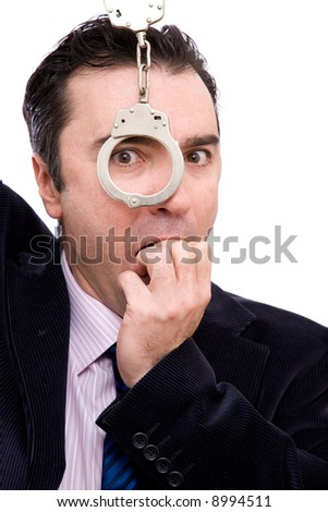 worried businessman portrait with handcuffs on white background