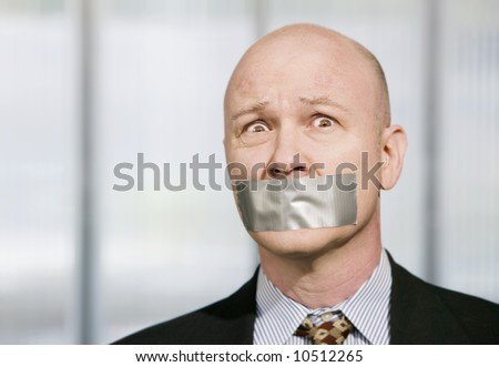 Worried businessman silenced with duct tape over his mouth