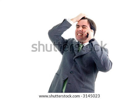Worried, freaked-out business man pulling his hair while yelling at a cell phone.
