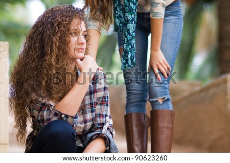 worried girl comforted by a friend