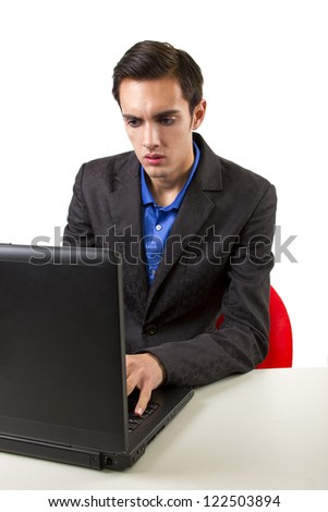 Worried male browsing the internet