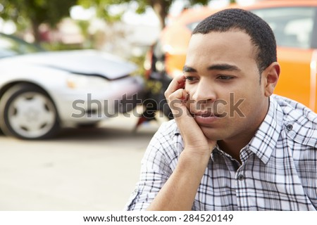 Worried Male Driver Sitting By Car After Traffic Accident