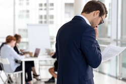 Worried male speaker stand outside conference room read notes feel scared to enter boardroom, anxious frightened man presenter repeat read paperwork report, afraid of public speaking