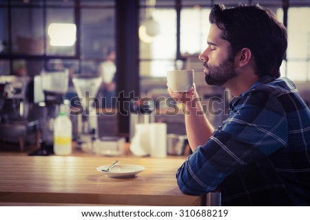 Worried man drinking a coffee at the cafe Foto stock ©
