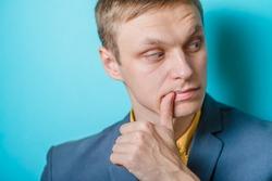 Worried  man nibbling his fingernails