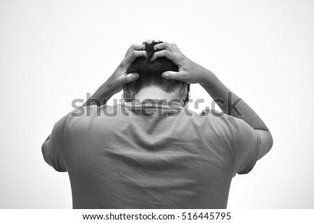 Worried man touching his head (Mental health)