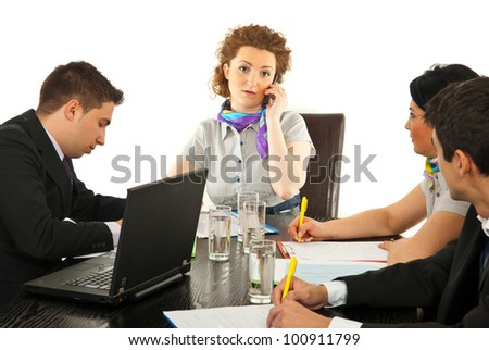 Worried manager woman talking by phone mobile and having meeting