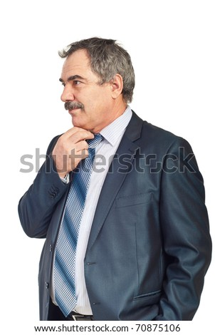 Worried mature business man thinking at solutions holding hand to chin and looking away isolated on white background