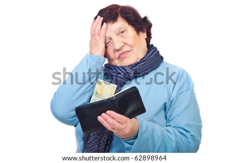 Worried pensioner holding a wallet with last  penny isolated on white background