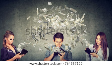 Worried sad man and two women looking at their wallets with money dollar banknotes flying out away