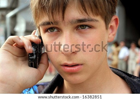 worried teenager speak phone