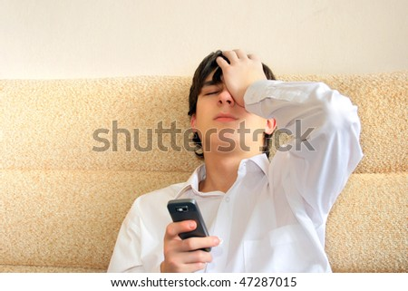 worried teenager with mobile phone