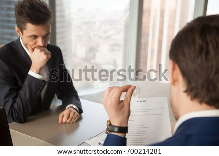 Worried unhired job applicant feeling nervous while employer or recruiter reviewing bad resume, unprepared vacancy candidate waiting for result, afraid to fail employment interview and be rejected #700214281