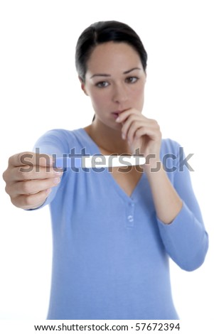 Worried woman holding pregnancy test