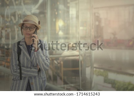 Photo of Worries free in case of fligh cancellation or schedule. Picture of traveller calling to the insurance company for a claim after her flight is cancellation and reschedule.