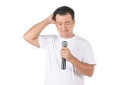 Worry or forget about speech concept. Portrait Asian man holding black wireless microphone and feel worry to speak studio Isolated on white background