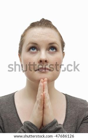 Worship - Cute christian woman praying to Jesus - stock photo