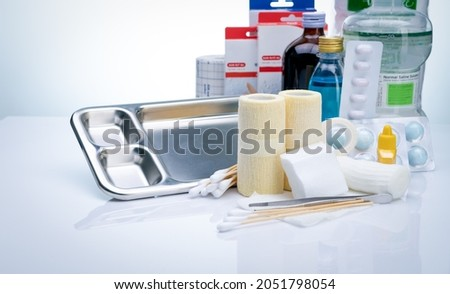 Wound care dressing set. Wound care equipment in hospital for nurse. Conform bandage, forceps, alcohol, cotton sticks, povidone-iodine for infection wound. Medical supply. Medical equipment for nurse. Foto d'archivio ©