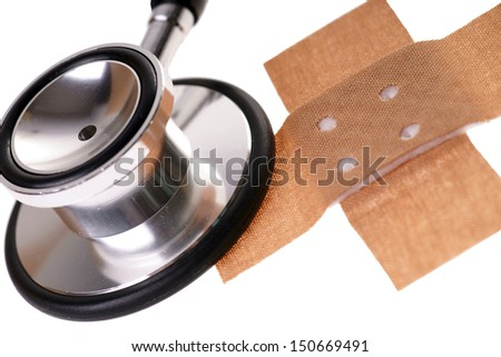 Wound plaster and stethoscope over a white background / health service