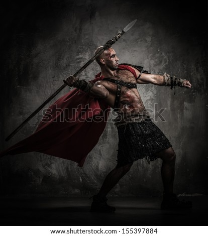 Wounded gladiator in red coat throwing spear