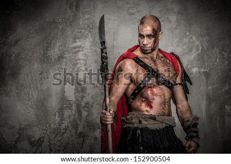 Wounded gladiator in red coat with spear