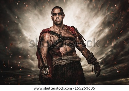 Wounded gladiator  with sword against stormy sky