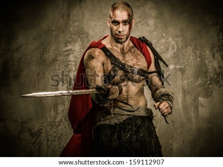 Wounded gladiator with sword covered in blood