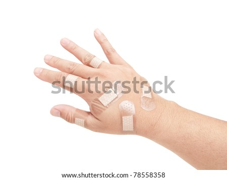 Wounded hand full of bandages on white background
