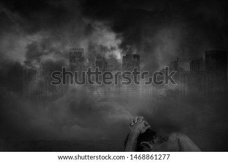 Wounded man victim while holding his head and the body has stains and bruises in abandoned large cities are covered with smoke, concept of victims of civil war