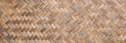 Woven bamboo wall Thai style pattern nature texture background. Basketry bamboo mat seamless pattern.  top view. Flat lay.