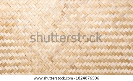 Woven bamboo wall Thai style pattern nature texture background. Basketry bamboo mat seamless pattern.  top view.