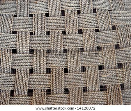 Woven cane over black