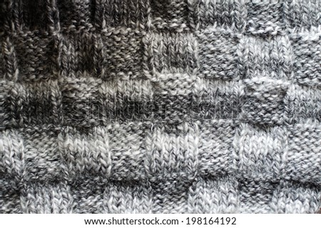 woven hand made knit woolen design texture, knitting sweater or jumper gray copy space background detail closeup picture