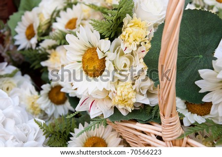 woven wicker basket arranged with beautiful white daisies