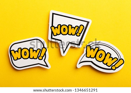 WOW concept speech bubble isolated on yellow background. #1346651291