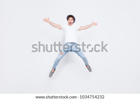 Wow! Full-length full-size portrait of crazy mad excited cheerful lucky leader dreamy handsome fashionable man jumping up like a star isolated on gray background