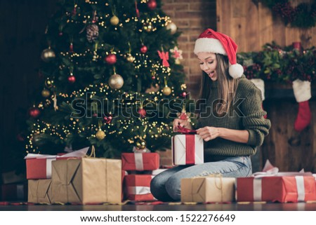 Wow its for me? Full length photo of excited emotional girl sit floor checkered plaid blanket get gift box for christmas enjoy newyear noel present  wear santa claus headwear in house indoors #1522276649